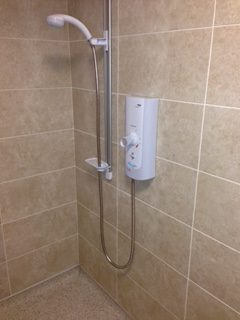 Electric shower installation and tiling